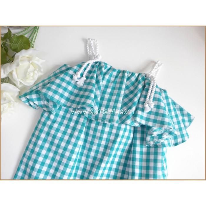 Conjunto blusa azul y bombacho blanco