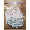 Vestido blanco con topitos grises  Atelier de Candela